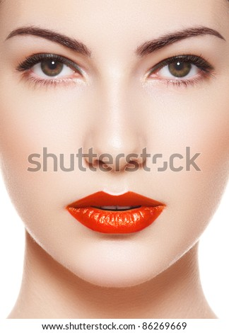 Cute model face with bright evening make-up, orange lipstick, purity skin on white background - stock photo