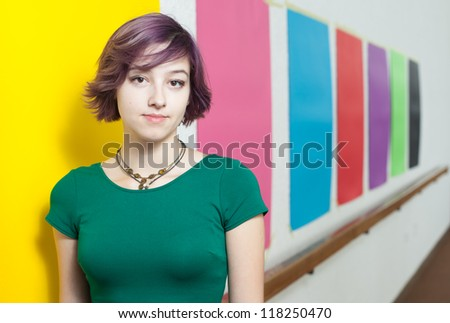 Cute modern and urban looking girl on multi-coloured background - stock photo
