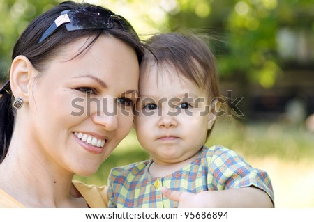 cute mom with little daughter at nature