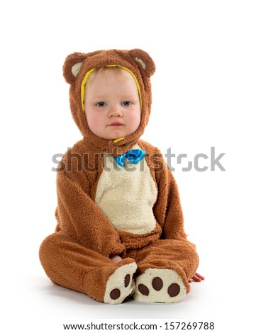 Cute 18-month-old baby boy in a bear costume for Halloween on white background. - stock photo