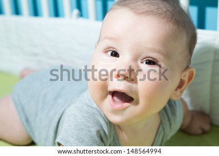 Cute 6 months old baby - stock photo
