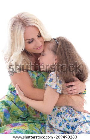 cute mother and daughter hugging isolated on white background