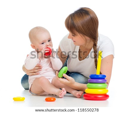 cute mother playing with baby - stock photo