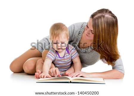 cute mother reading a book to her kid boy - stock photo