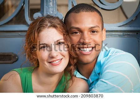 Cute Multiracial couple hugging. - stock photo