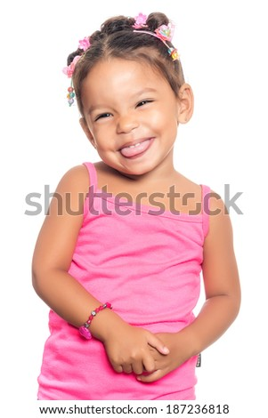 Cute multiracial small girl with a funny expression isolated on a white background - stock photo