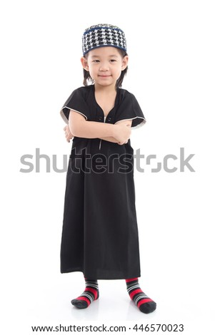 Cute muslim child lying on white background isolated.