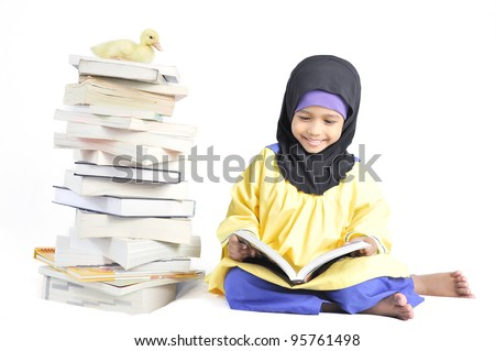 Cute Muslim girl reading book in isolated white background. - stock photo