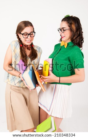 cute nerdy girls bump into each other. - stock photo