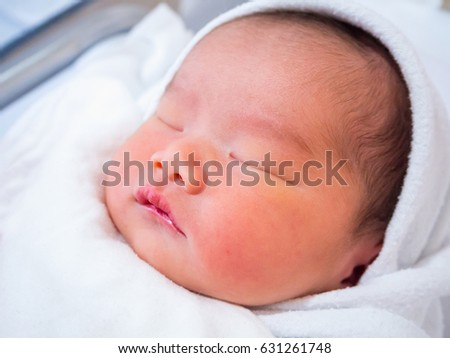 Cute newborn asian baby girl sleeping