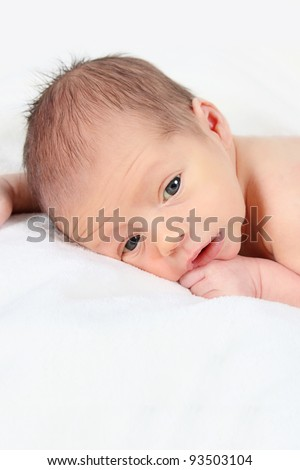 Cute newborn baby boy posing for camera - stock photo