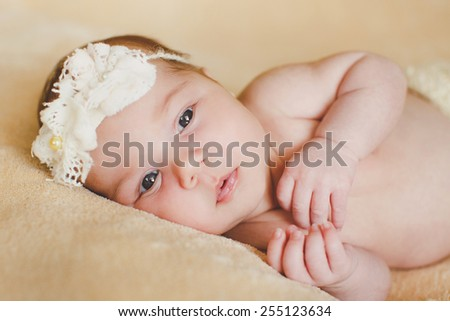 Cute newborn baby girl. adorable newborn baby girl lies on blanket. - stock photo