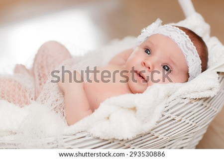Cute newborn baby girl 1 month child sleeping in basket adorable little girl new born