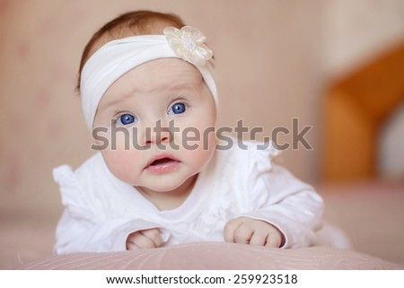 Cute newborn baby girl. Portrait of a cute 3 months baby lying down on a blanket - stock photo