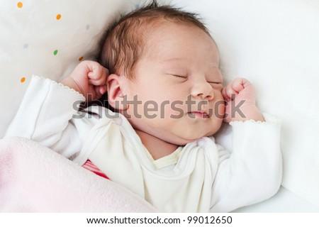 Cute newborn baby girl sleeping portrait. - stock photo