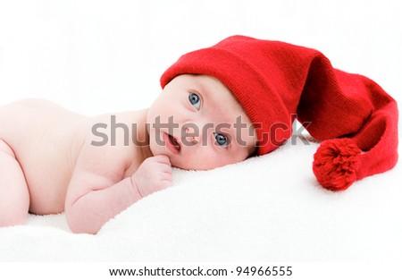 Cute newborn baby in a hat - stock photo