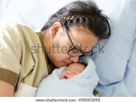 cute newborn baby (infant aged one day)