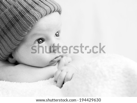 cute newborn baby looking to the left  ( black-white ) - stock photo
