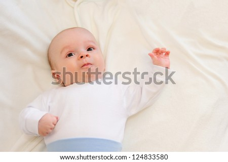 Cute newborn baby lying in bed on blanket - stock photo