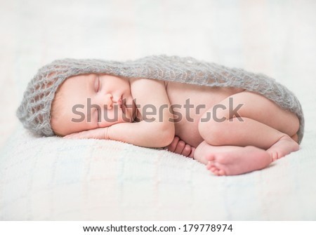 cute newborn baby sleeping on fluffy lace scarf - stock photo