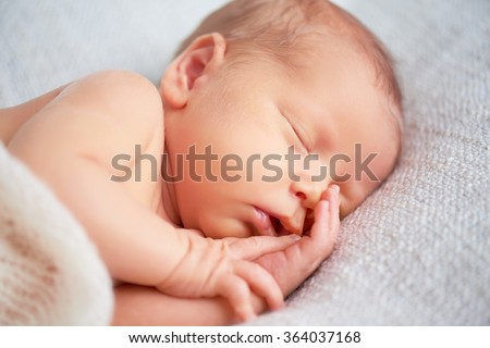 Cute newborn baby sleeps in white - stock photo