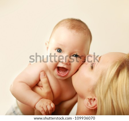 Cute newborn in mother's - stock photo