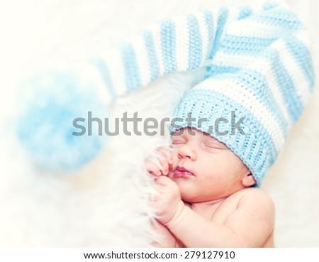 Cute newborn sleeping baby boy - stock photo