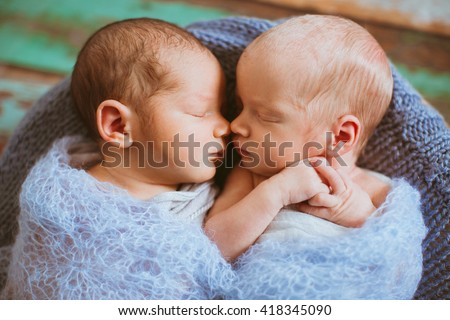 Cute newborns are lying next to each other - stock photo