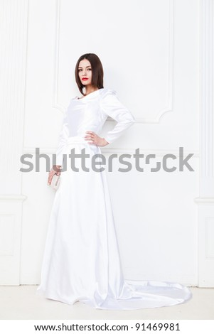 Cute of a young bride wearing white bridal elegance strict dress