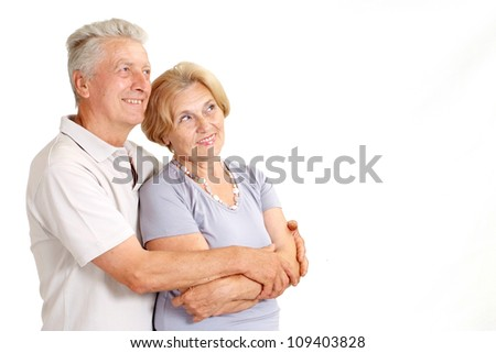 Cute old couple at home on a white background