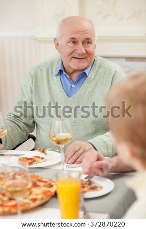 Cute old married couple has a lunch - stock photo