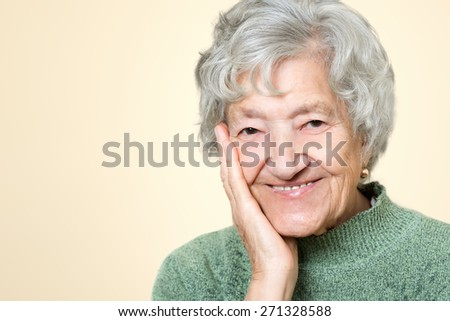 Cute old senior lady portrait - stock photo
