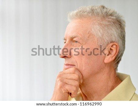 cute older man poses in a room - stock photo