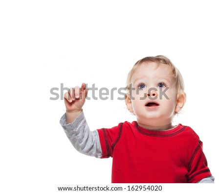 Cute one year old baby boy looking up and pointing. Isolated on white. - stock photo