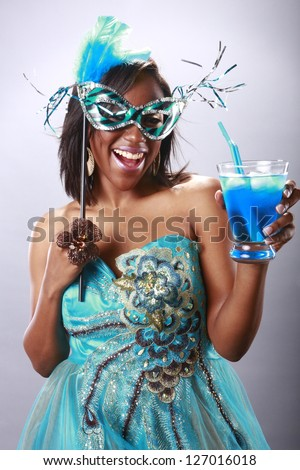 Cute party girl and blue cocktail - stock photo
