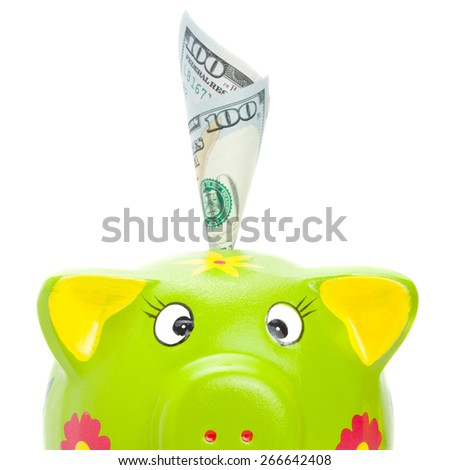 Cute piggy bank with 100 US dollars in it - stock photo
