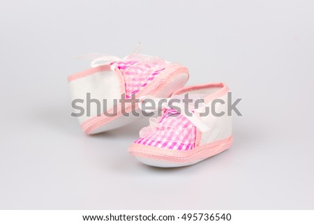 Cute pink baby girl shoes close up