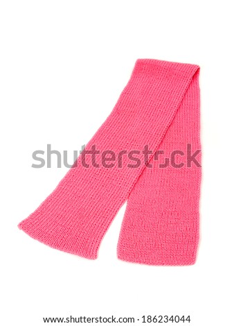 Cute pink winter scarf nicely arranged. Wool scarf isolated on white background. - stock photo