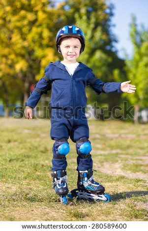 Cute playful skater boy posing in the park - stock photo