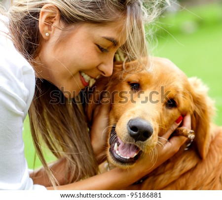 Cute portrait of a woman with her dog at the park - stock photo