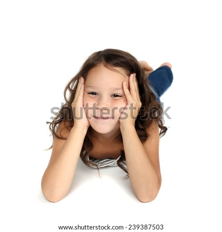 cute preschooler girl lying on the floor and thinking