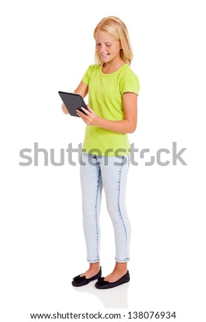 cute preteen girl using tablet computer isolated on white - stock photo