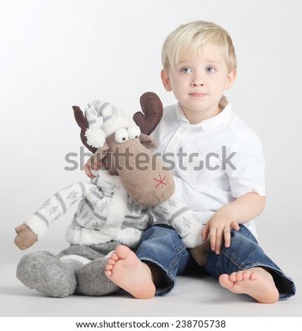 Cute, pretty boy posing in studio - stock photo