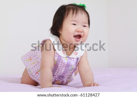 Cute Pretty Eleven Month Old Asian Infant Baby Girl in Purple and White Dress Leaning Crawling Forward and Smiling