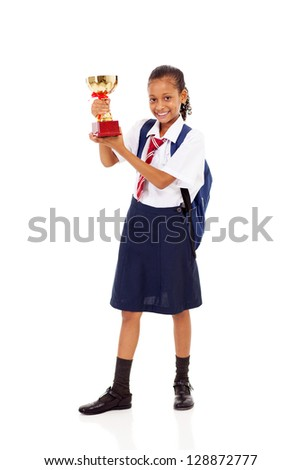cute primary schoolgirl holding a trophy isolated on white