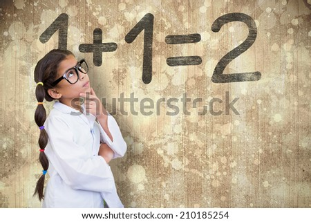 Cute pupil dressed up as scientist against wooden surface with planks