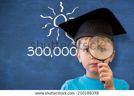 Cute pupil looking through magnifying glass against blue chalkboard - stock photo