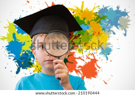 Cute pupil looking through magnifying glass against white background with paint splashes - stock photo