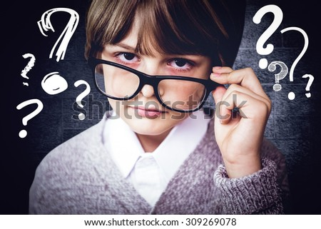 Cute pupil pretending to be teacher against black background - stock photo
