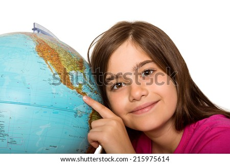 Cute pupil smiling with globe on white background - stock photo